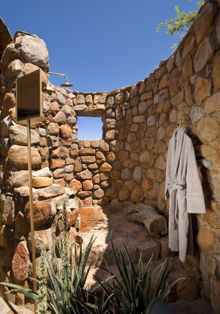 rustic outdoor shower - rock wall shower with integral window of the Motse cottage at Twaslu game preserve in South Africa - Twaslu.com via Atticmag