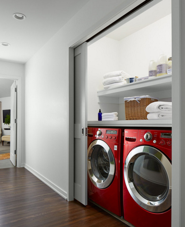 front load washing machine - a pair of LG front loaders fits neatly under a counter in a closet - mapeterson.com via atticmag