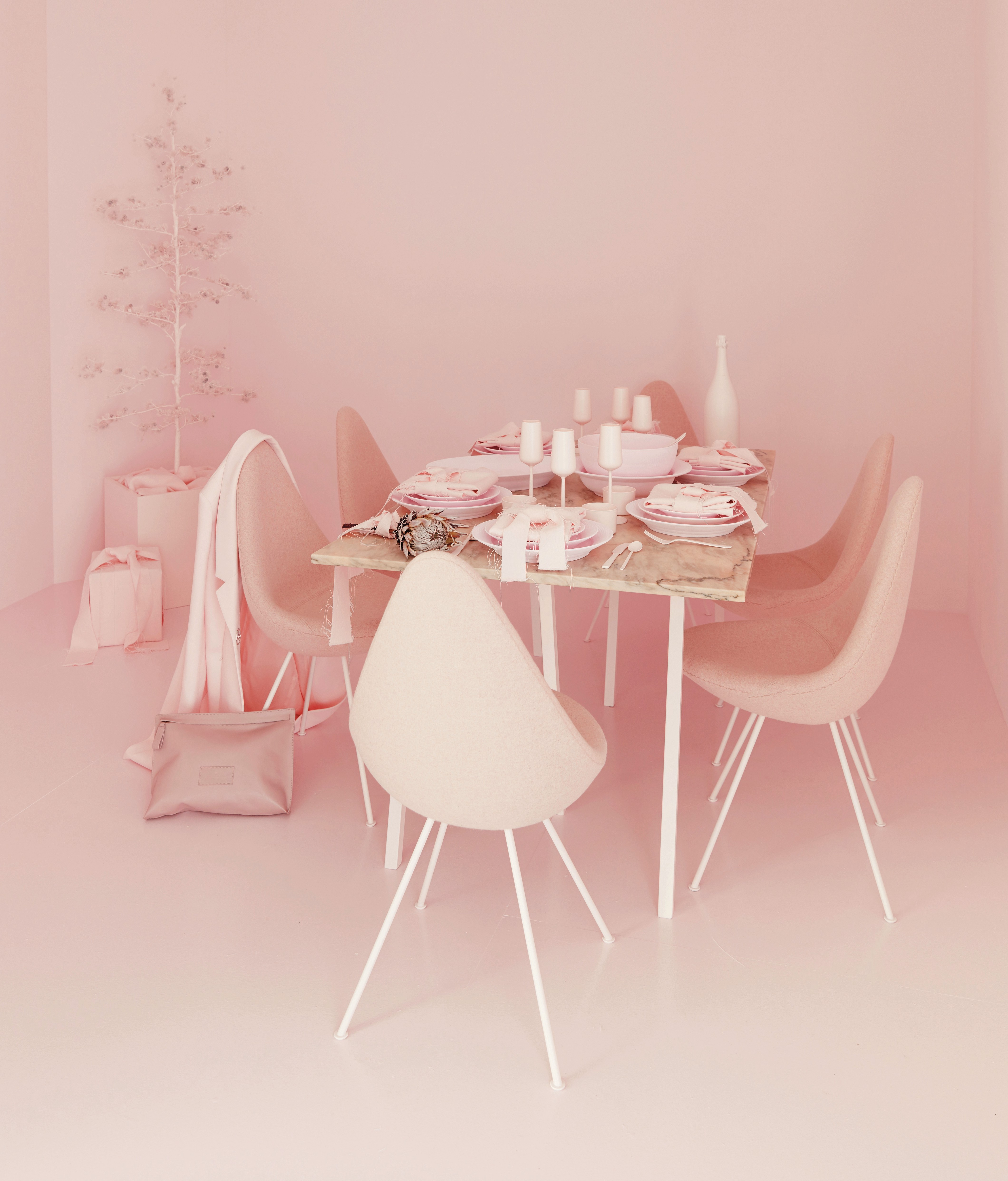 "fashionable Christmas - a modern marble-topped table goes blush pink for Charlotte Eskildsen's ""think pink"" Christmas inspiration - Royal Copenhagen via Atticmag"