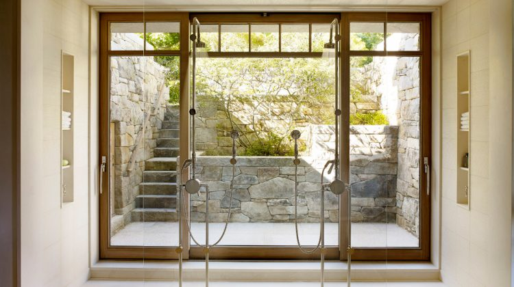 freestanding showers - a pair of freestanding Waterworks showers by architect Tom Kligerman in a master bath of an oceanside house - Ike Kligerman Barkley via Atticmag