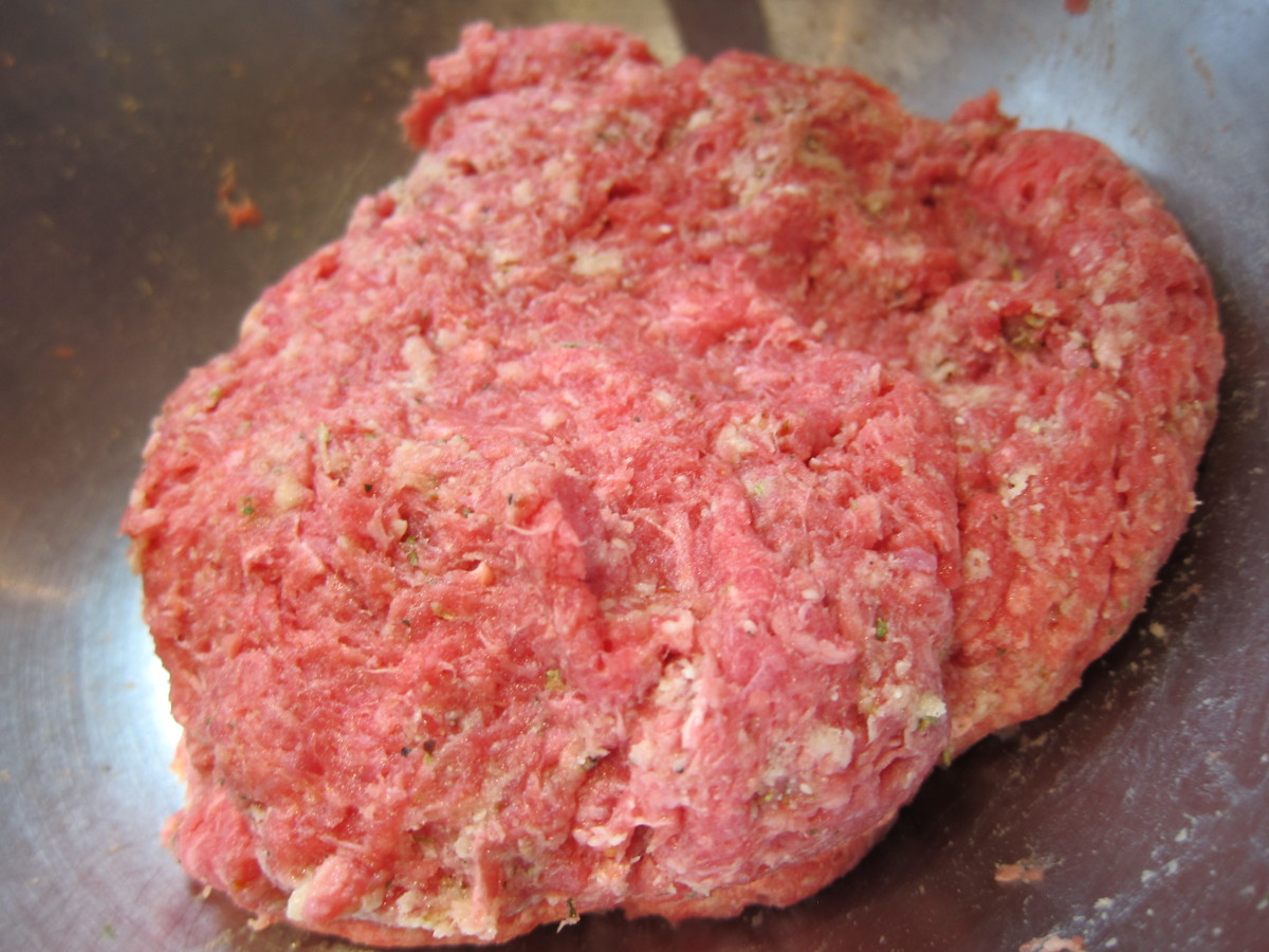 breadcrumb and seasoning base is mixed into the ground beef until the ingredients look marbled for black Angus meatballs - Atticmag
