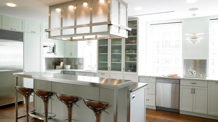 pale green kitchens - modern urban kitchen with pale green cabinets and stainless steel accents - Peter Pennoyer Architects via Atticmag
