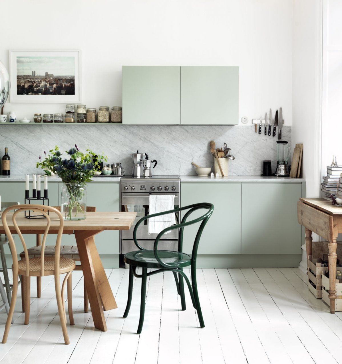 pale green kitchens - Emma Persson Lagerberg's pale green Swedish kitchen with white-painted floor - bloesem via Atticmag
