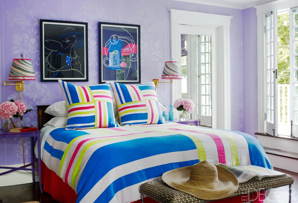 striped décor - Long Island master bedroom of Amy Fine Collins has a beach-towel striped bedspread and pillow shams and swirled striped lamp shades - Elle Décor via Atticmag