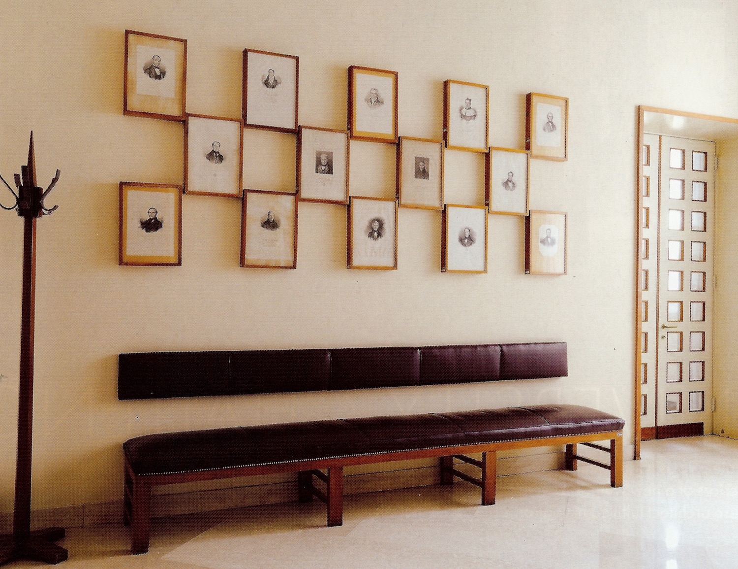 grand picture walls - staggered integrated picture wall of engravings designed by Milanese architect Giò Ponti in a university building in Padua - World of Interiors via Atticmag