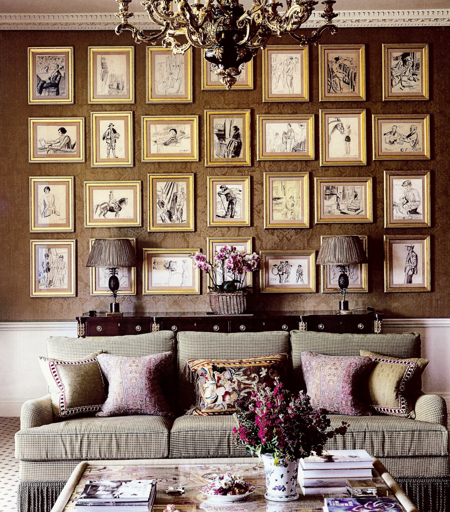 grand picture wall - 28 drawings from a portfolio by Dame Laura Knight as massed on the drawing room wall of Williamstrip, a historic house in the Cotswolds - House & Garden via Atticmag