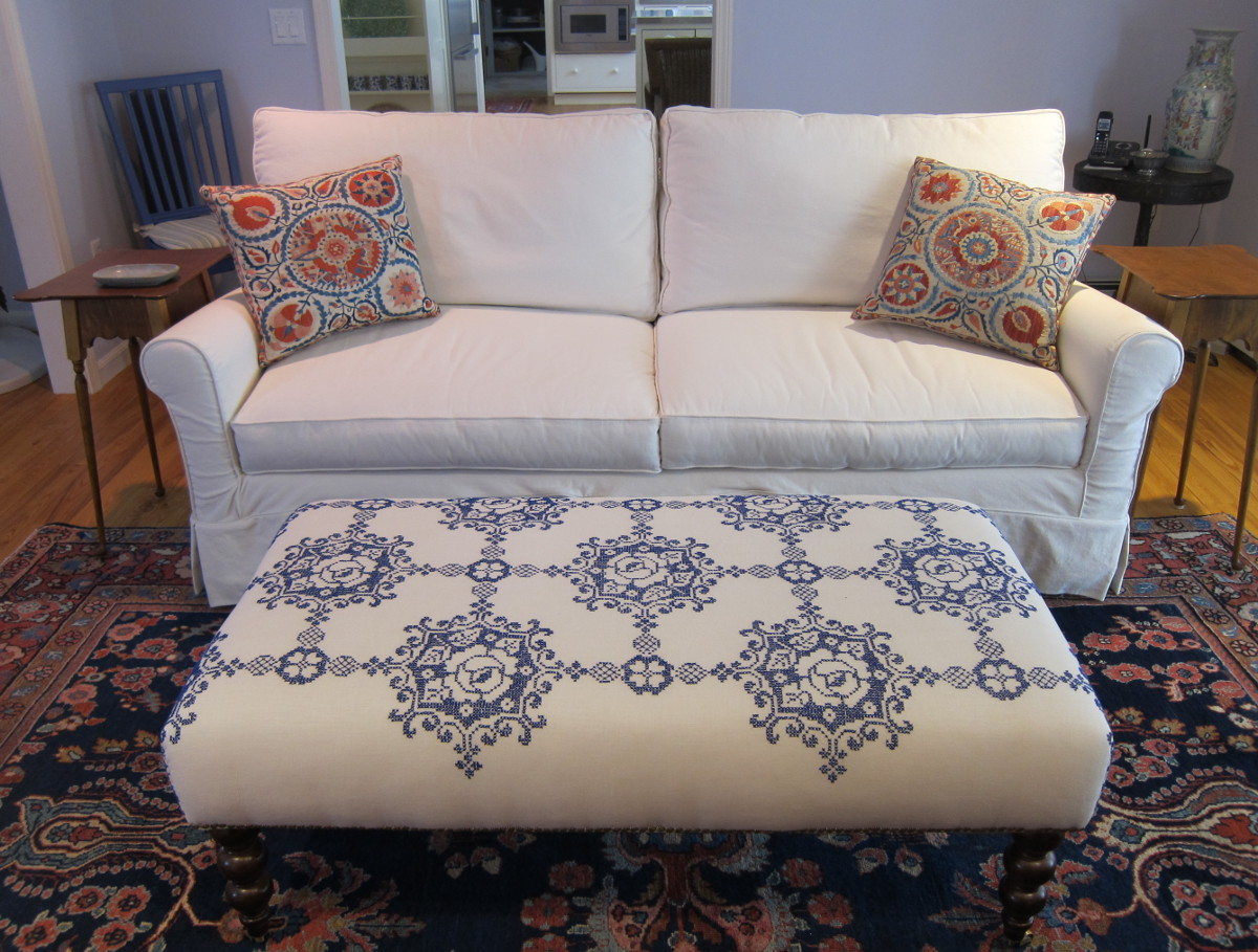 vintage tablecloth repurposed as an ottoman cover - Atticmag