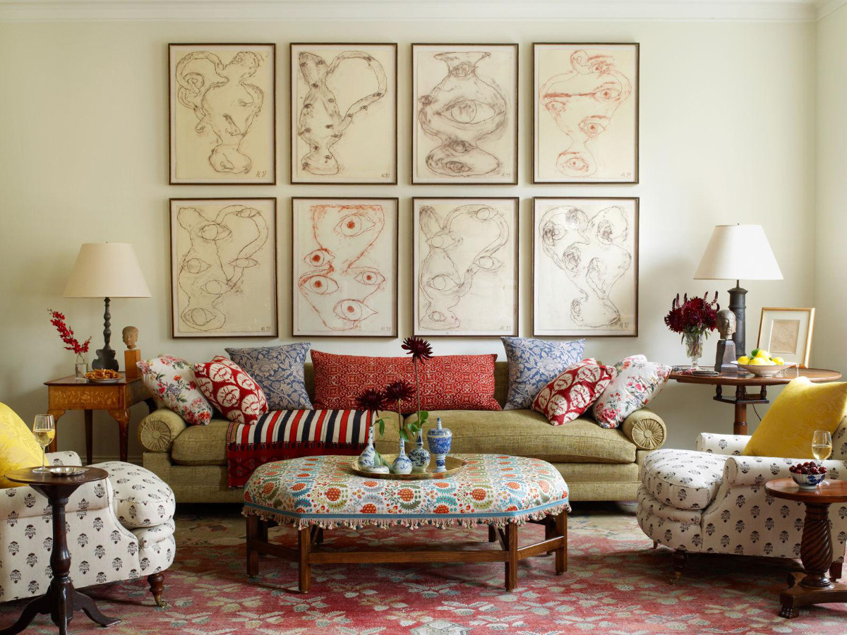 repurposed vintage tablecloth - suzani-covered ottoman in a room by Daniel Sachs - House Beautiful via Atticmag