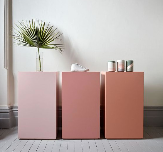 peony pink - variegated display stands in gradient shades of pink - Flack Studio via Atticmag