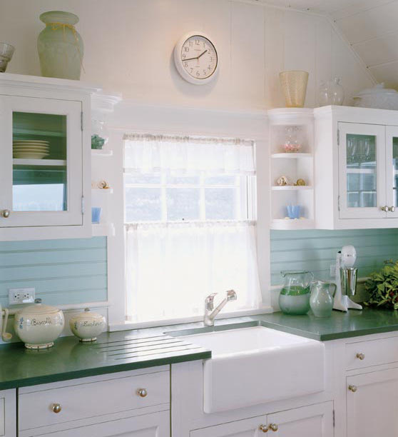 seaglass blue - kitchen sink in white and blue kitchen with green counters - Hutker Architects via Atticmag