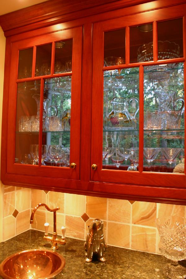 cherry cabinets - see through upper cherry cabinet with glass doors in butler's pantry - Lorie McMillan via Atticmag