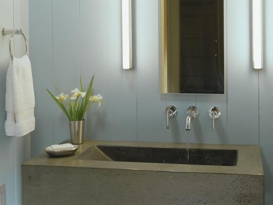 concrete sink - modern concrete bathroom sink with sloping sides- Hutker Architects via Atticmag
