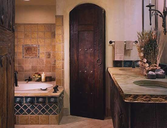 California mediterranean rustic bath with antique wood door, and rustic tile - Conceptual Design via Atticmag