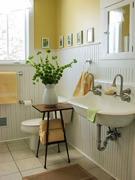 yellow cottage bathroom with white beadboard - via Atticmag