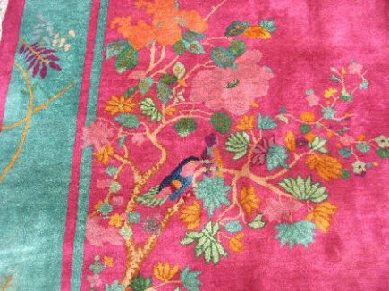 Chinese Art Deco rugs - rug with a turquoise band and hot pink field that includes flowers and birds - via Atticmag