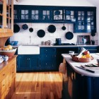 kitchen with cobalt blue cabinets mixed with white and natural wood - Hutker Architects via Atticmag
