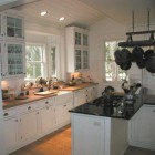 cooktop in island kitchen - black and white kitchen with cooktop in the working side of a peninsula/island - via Atticmag