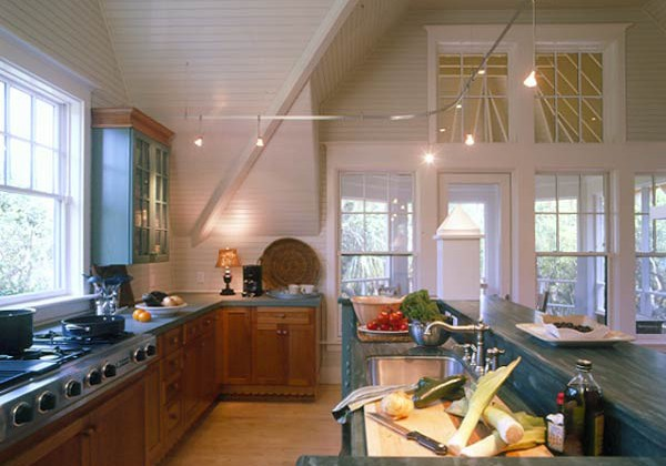 country kitchen with loft ceiling and green slate counter - via Atticmag