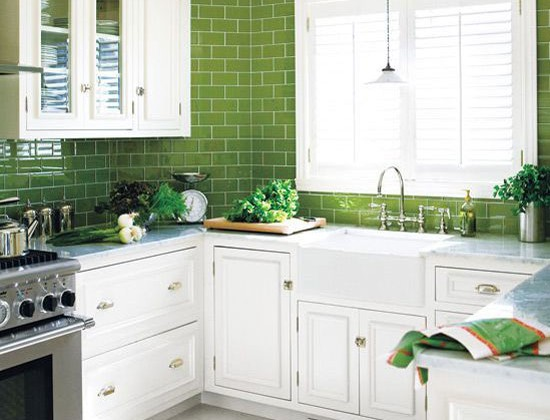 eurosplash - white kitchen with spinach-colored glaze tile counter-to-ceiling backsplash - Style at Home via Atticmag