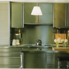 Stainless steel kitchen by Bulthaup -Hamptons Cottages & Gardens via Atticmag