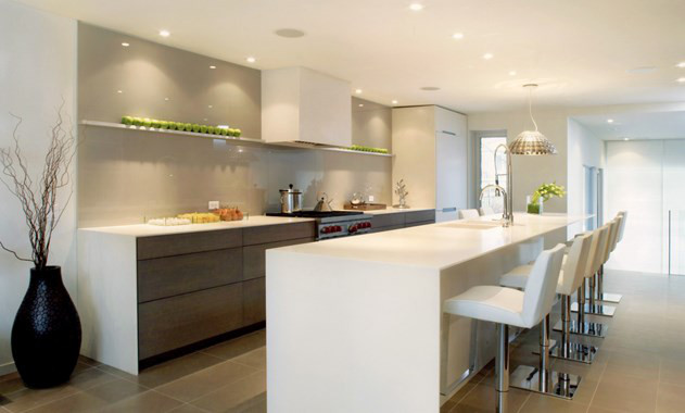 minimalist kitchen - white modern kitchen with beige backsplash by Elaine Cecconi - Wolf/SubZero via Atticmag