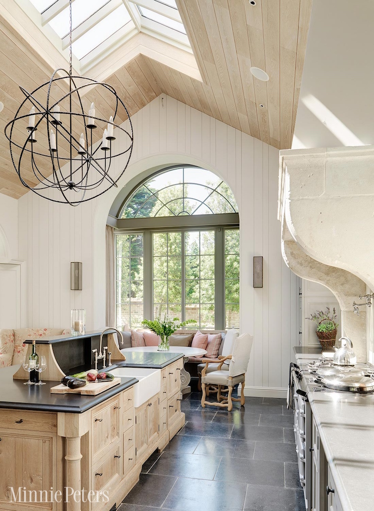 custard color kitchen - white and cream French kitchen with shiplap light wood ceiling and pine island - Minnie Peters via Atticmag