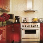 red lacquer cabinets with a white mosaic backsplash in a modern apartment kitchen - Elle Decor via Atticmag