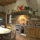 modern tuscan kitchen - a fitted kitchen in an old Tuscan villa retains the traditional style - Il Trebbio via Atticmag