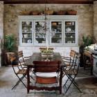 unfitted stone house kitchen with a white hutch - Elle Décor via Atticmag