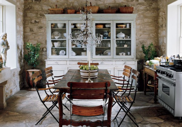 unfitted stone house kitchen with a white hutch - Elle Décor via Atticmag
