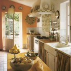 spanish country kitchen - rustic and informal kitchen with fabric skirts and a marble farm sink - WOI via Aticmag