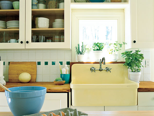 wall mount kitchen sink - Kohler's Gilford sink in sunlight - Southern Living via Atticmag