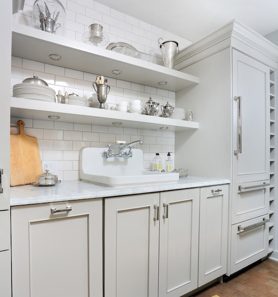 wall mount kitchen sink - white kohler gilford sink in a pale gray kitchen - Normandy Remodeling via Atticmag