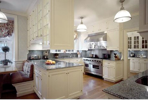 In An American Manor House A White Kitchen Has Exceptional Gl Door Cabinets
