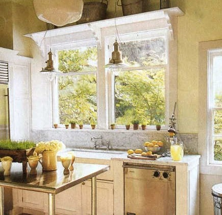 white old-house kitchen with marble backsplash and industrial work table