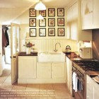 off center faucet in a white kitchen with a double farm sink - Traditional Home via Atticmag