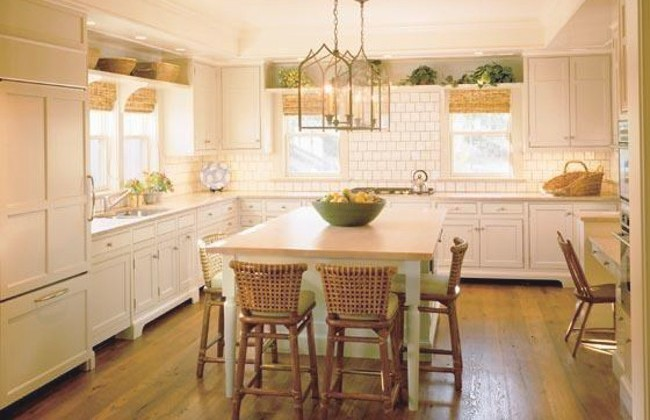 rattan accents - white traditional kitchen with natural rattan furniture and window coverings - Hutker Architects via Atticmag