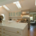 triple skylight kitchen - Martha Stewart's former white Connecticut kitchen with 3 skylights - via Atticmag