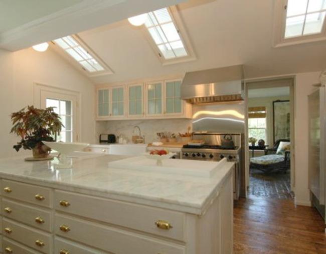 triple skylight kitchen - Martha Stewart's former white Connecticut kitchen with 3 skylights - via Atticmag