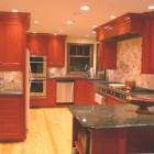 cherry cabinets - cherry cabinet kitchen with onyx backsplash - Lorie McMillan via Atticmag