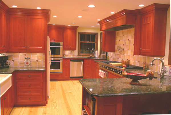 cherry cabinets - cherry cabinet kitchen with onyx backsplash - Lorie McMillan via Atticmag