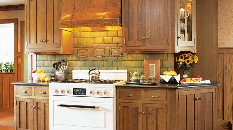 copper hood - Arts and Crafts Crown Point oak cabinets with copper hood and Heartland range - Crown Point via Atticmag