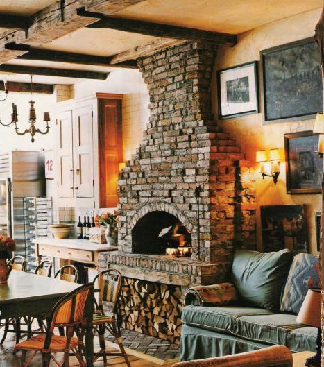 salvage kitchen - Brian McNally's Greenwich Village kitchen with open sitting room and fireplace - NY Mag via Atticmag