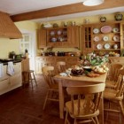 double hutch kitchen - natural pine kitchen with a pair of hutches and a cream-colored Aga - Mariette Himes Gomez via Atticmag