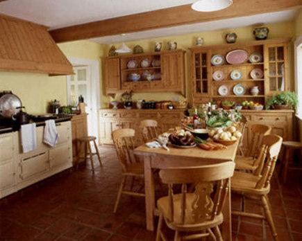 double hutch kitchen - natural pine kitchen with a pair of hutches and a cream-colored Aga - Mariette Himes Gomez via Atticmag