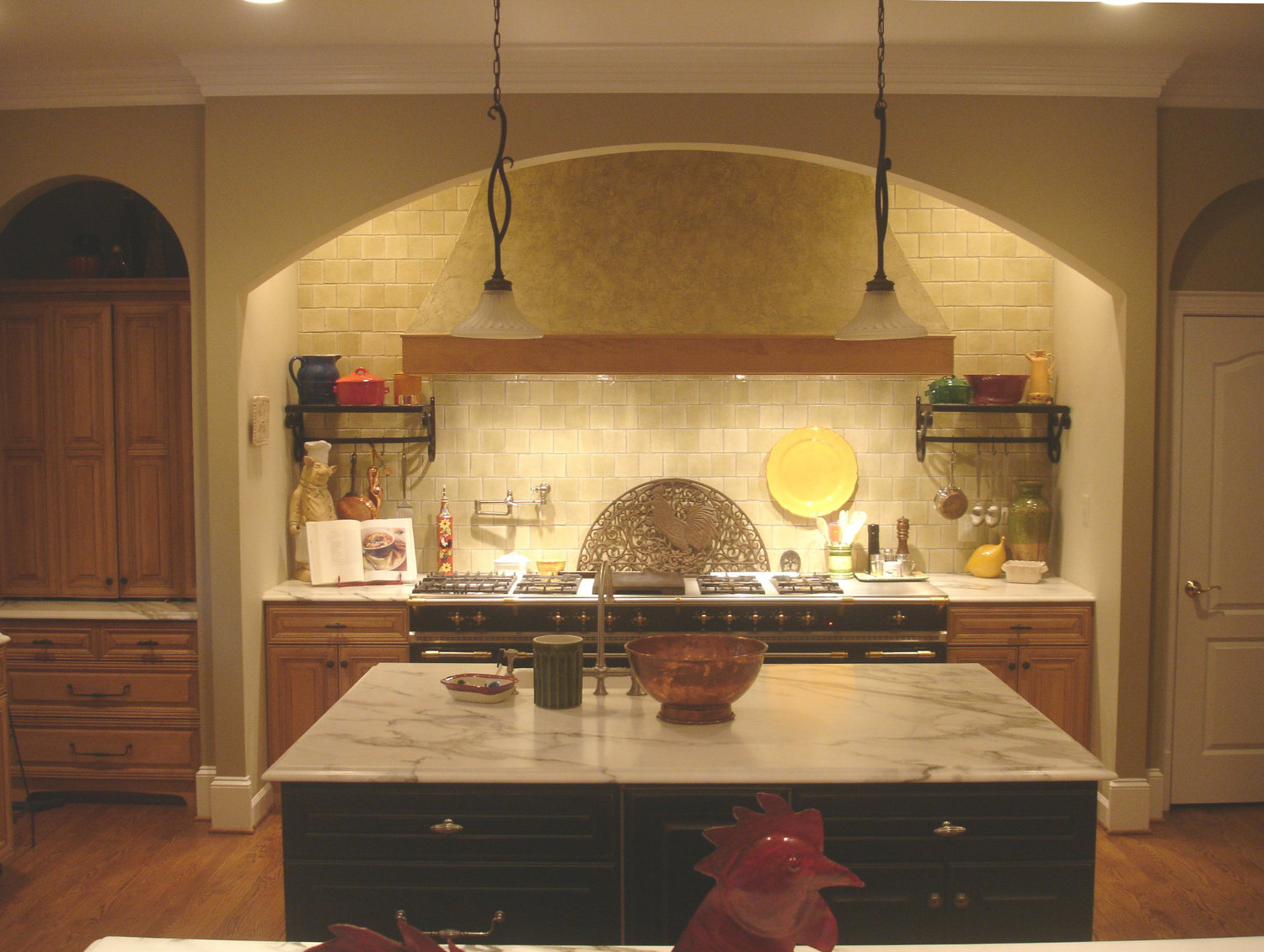 maple cabinet family kitchen with black and green accents - Atticmag