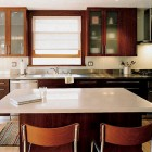 neutral wood cabinet kitchen with stainless steel counters - gardenweb via Atticmag