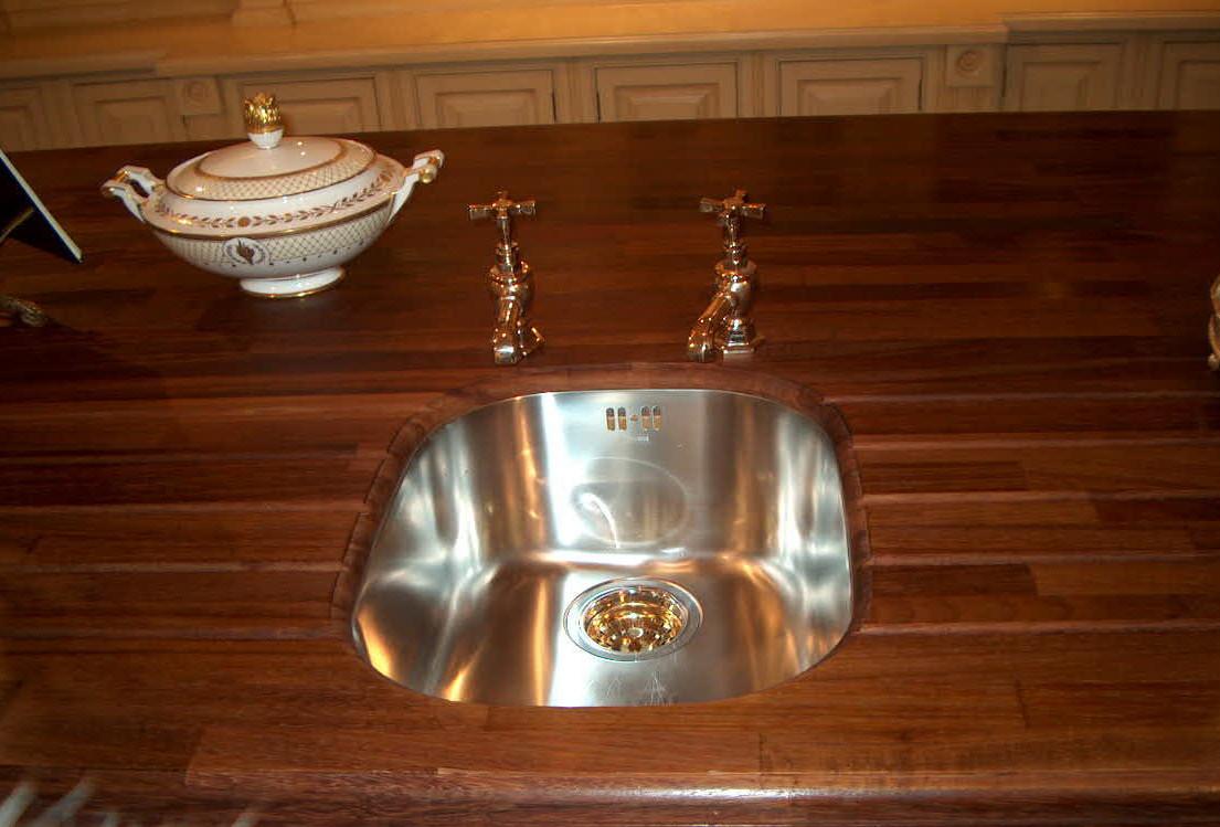 Prep sink in Clive Christian buttercream kitchen island - Atticmag