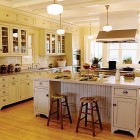 yellow double island Victorian style Crown Point kitchen - via Atticmag