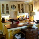 sunflower yellow and white kitchen with an Aga range - Fairfax & Sammons via Atticmag